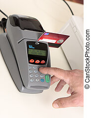 Credit or debit card transaction - A retailer, salesman or...