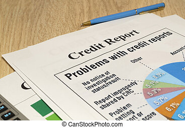 Credit report chart with pen and calculator.