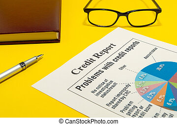 Credit report on the yellow table and a pen