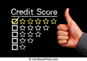 Credit score concept is on the blackboard with thumb up hand...