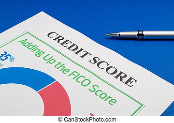 Credit score report and pen on the blue table