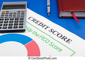 Credit score report with calculator on a blue table.
