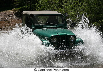 Creek Crossing - Off-road vehicle fording a stream creates...