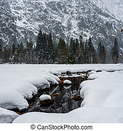 Creek Cuts Through Snow Covered Meadow