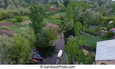 Creek Through Farmland and Homes 2 - Drone, exterior, wide...