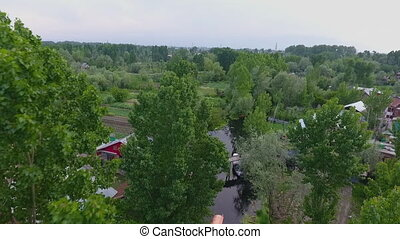 Creek Through Farmland and Homes - Drone, exterior, wide...