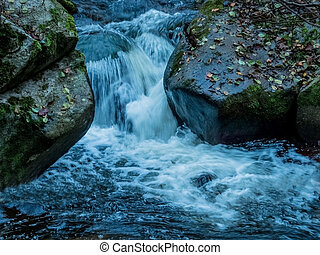 creek with running water - a creek with rocks and running...