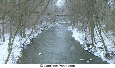 Creek with Snow Falling