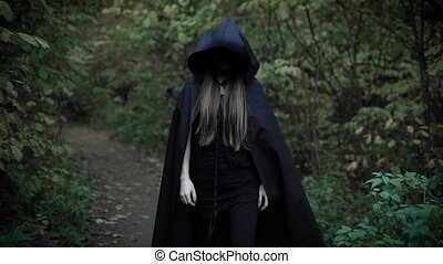 Creepy blonde woman walks in the woods. - Dressed as a witch...