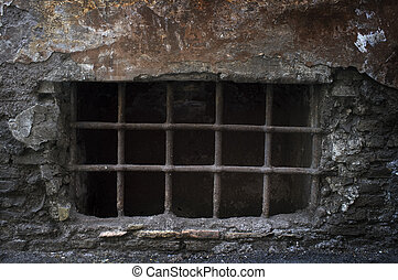 Creepy Cellar - Old creepy cellar window with bars.