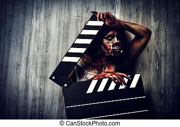 creepy cinema - Filming a horror movie. Female zombie...