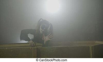 Creepy female dolly zombie closing her vampire partner in...