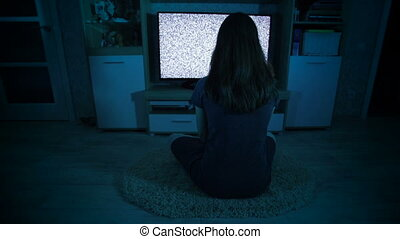 Creepy girl waching TV with grain - Creepy girl waching TV...