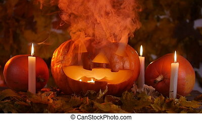 Creepy halloween pumpkins and candles in the smoke....