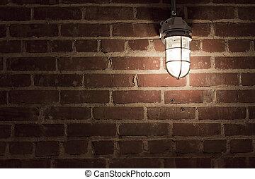 Creepy light on textrued brick wall