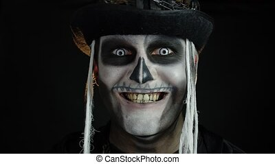 Creepy man face in skeleton Halloween cosplay appearing on ...