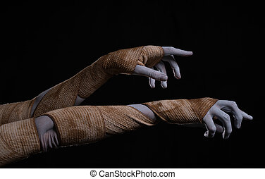 Creepy mummy stretching hands wrapped in bandages