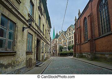 Creepy old medieval narrow street in Riga, Latvia.