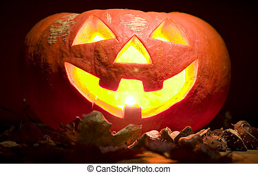 Creepy pumpkin with candle in mouth, halloween concept