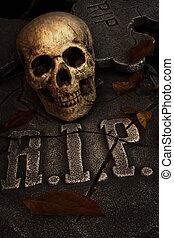 Creepy skull on gravestone in cemetary