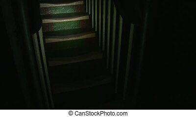 Creepy staircase for production - A steady medium shot of a...
