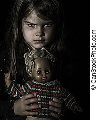 Creepy young girl with scary doll