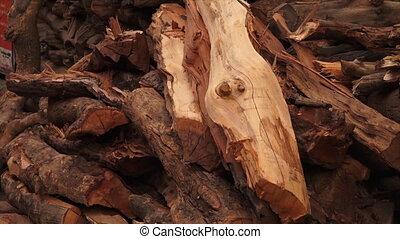 Cremation firewood at, Markarnika Ghat , India - Extreme...