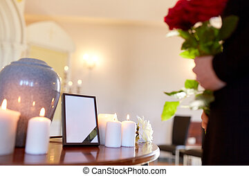 cremation urn and woman at funeral in church - cremation, ...
