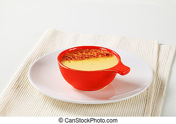 Creme brulee in a red dish