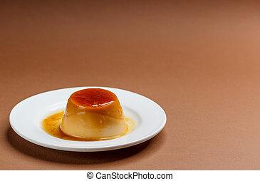 Creme caramel on white plate