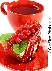 Crepe cake and a red cup of tea.