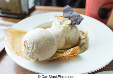 Crepe with ice cream and banana burned topping
