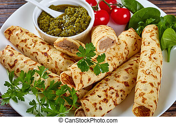 crepes stuffed with chicken meat, close-up