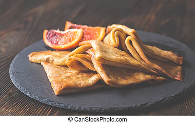 Crepes Suzette on the stone board - Crepes Suzette with ...