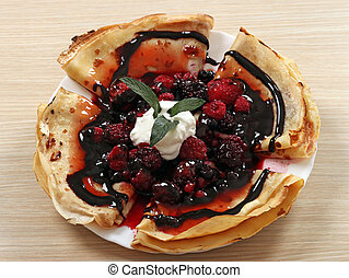 crepes with berries and chocolate dessert