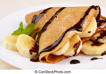 Crepes with chocolate sauce - French style crepes with...