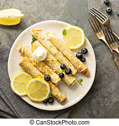 Crepes with lemon filling and blueberries