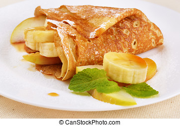 Crepes with maple syrup - French style crepes with banana,...
