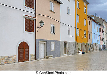 Cres houses - Colourful medieval in row houses at Cres ...