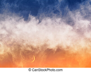 Swirling clouds and fog hovering in the sky just after sunset with a crescent moon just above the horizon.