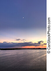 Crescent moon over New Pass from Estero Bay Sunset in Bonita Springs