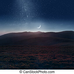 Crescent moon over the mountains