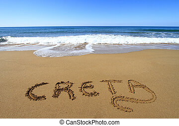 Creta written on sandy beach