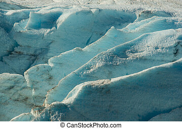 Crevasses in Portage Glacier showing the deep blue of...
