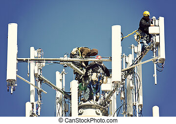 Crew installing antennas on the top of 150' water tower