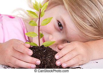 criança, com, planta, sorrindo