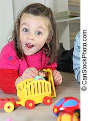 criança jovem, tocando, com, dela, brinquedos