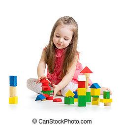 criança, menina, tocando, com, coloridos, bloco edifício,...