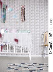 Crib against white wall