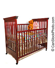 Crib Waiting For Baby - A dark cherry crib is dressed for ...